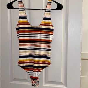 Twist back striped body suit